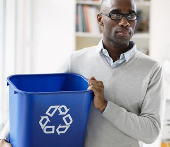 Image of a man with a recycle bin